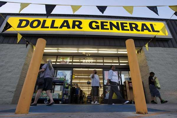 Customers exit a Dollar General store in San