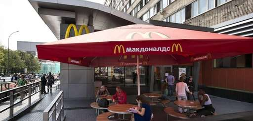 People walk past the oldest Moscow's McDonald's outlet