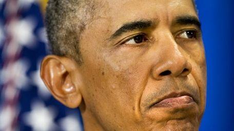 U.S. President Barack Obama pauses as he speaks