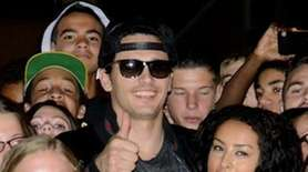 Actor James Franco poses with fans outside East