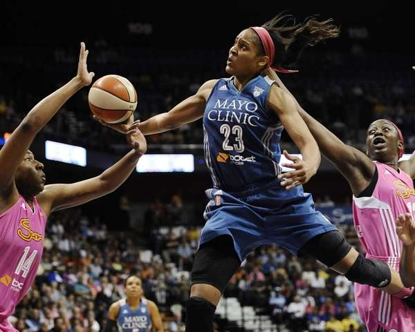 Minnesota Lynx's Maya Moore, center, glides to the