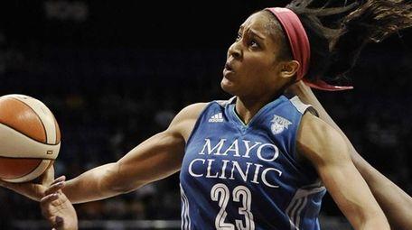 Minnesota Lynx's Maya Moore, center, glides to the