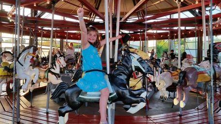 Amanda Lundquist, 8, of West Islip, plucked the