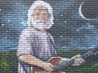 A mural of Jerry Garcia decorates an outside