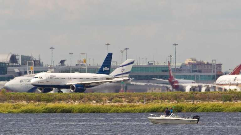 Airplanes on the runway of Kennedy Airport, as