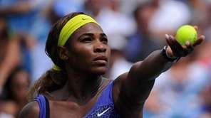 Serena Williams serves against Ana Ivanovic of Serbia