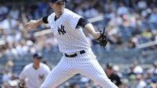 Yankees starting pitcher Brandon McCarthy delivers against the