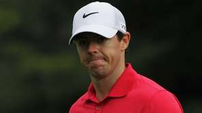 Rory McIlroy reacts on the 12th tee during