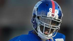 Giants defensive end Jason Pierre-Paul walks off the