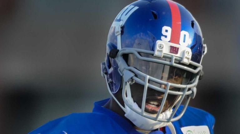 Giants defensive end Jason Pierre-Paul walks off the