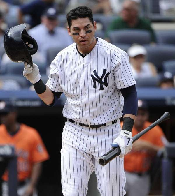 Yankees' Jacoby Ellsbury reacts after he strikes out
