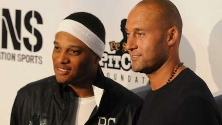 Yankees shortstop Derek Jeter, right, and Seattle Mariners
