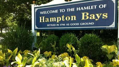 FILE: A sign welcomes visitors to the hamlet