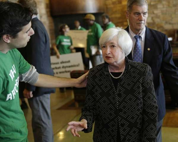 Federal Reserve Chair Janet Yellen, right, speaks with