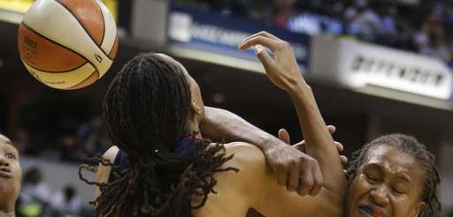Washington Mystics' Monique Currie and Indiana Fever's Tamika