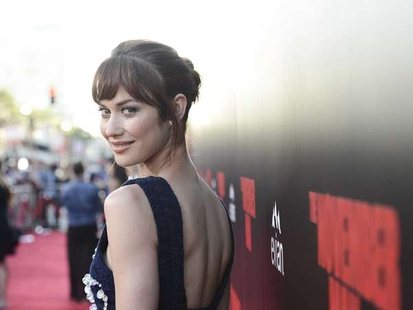 Olga Kurylenko attends the premiere of