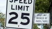 A speed limit sign is seen along Stewart