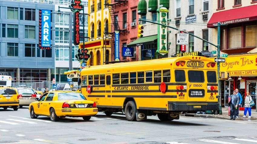 Yellow school bus on 8th Avenue in New