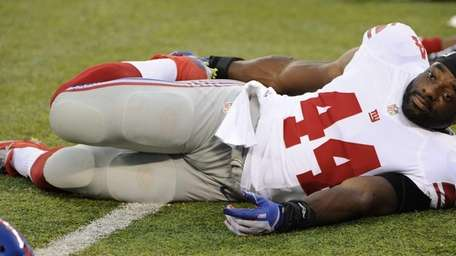 New York Giants running back Andre Williams stretches