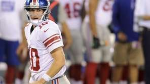 Giants quarterback Eli Manning gets up off the