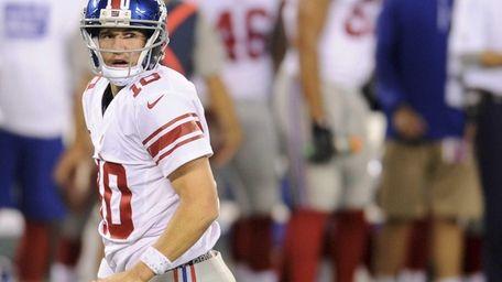 Giants quarterback Eli Manning gets up off the