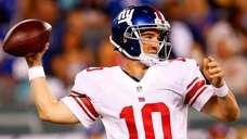 Eli Manning passes during the first quarter of