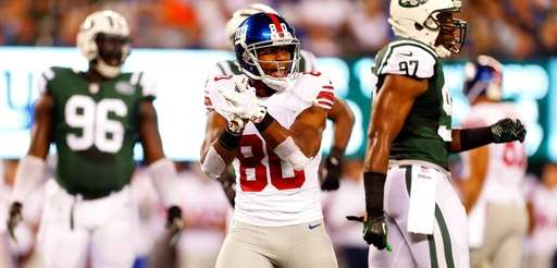 Giants wide receiver Victor Cruz celebrates a penalty