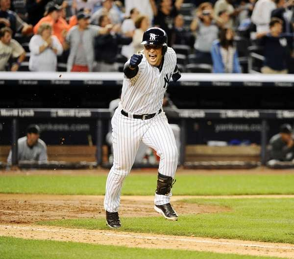 Martin Prado of the Yankees celebrating after hitting