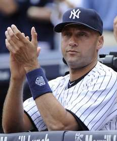 Yankees' Derek Jeter reacts during the ceremony honoring