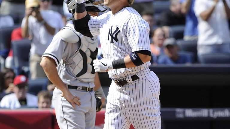 Carlos Beltran reacts after scoring on his home