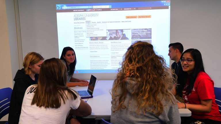Adelphi students work in the new digitized classroom