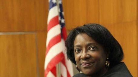 Judge Michele Woodard, of Westbury, stands in her