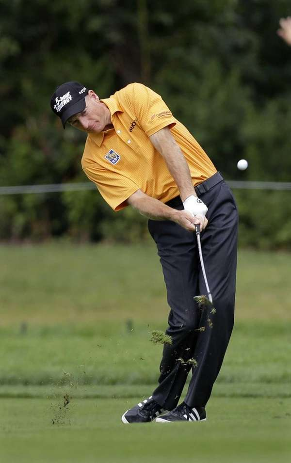 Jim Furyk hits a fairway shot on the