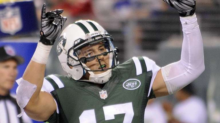 Jets wide receiver Greg Salas reacts after catching