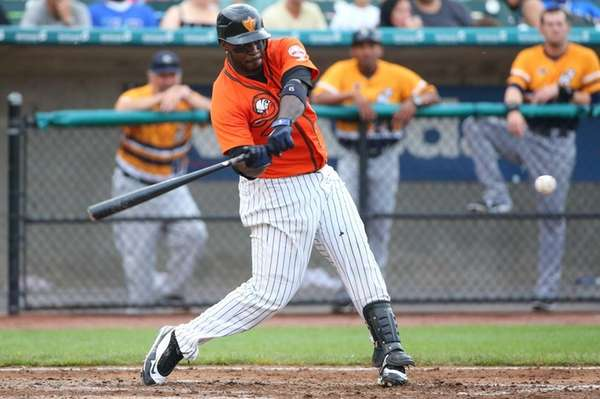 Long Island Ducks infielder Bill Hall singles to