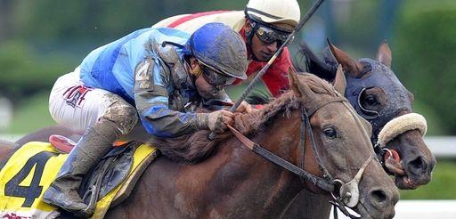 V.E. Day with jockey Javier Castellano up, moves