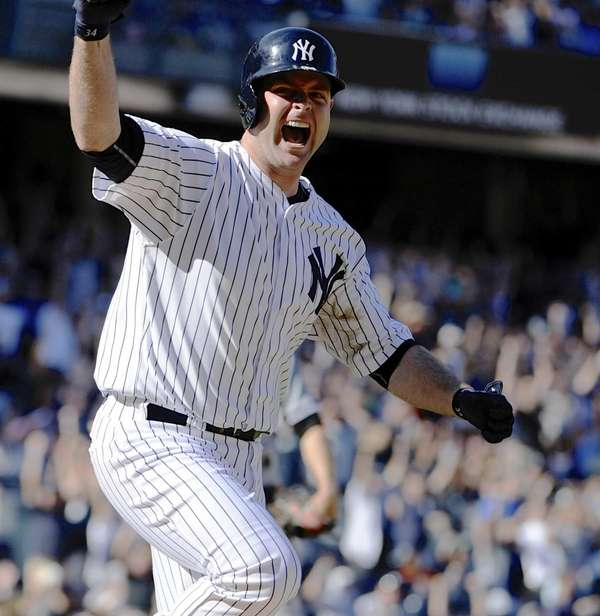The Yankees' Brian McCann reacts as he runs