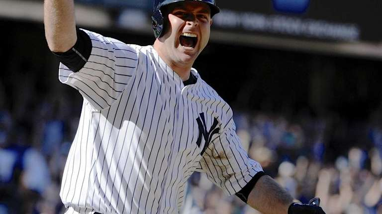 The Yankees' Brian McCann reacts as he runs