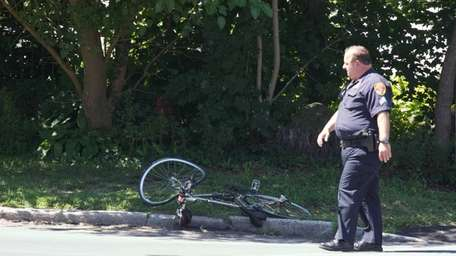 A Suffolk County Police Officer stands near a