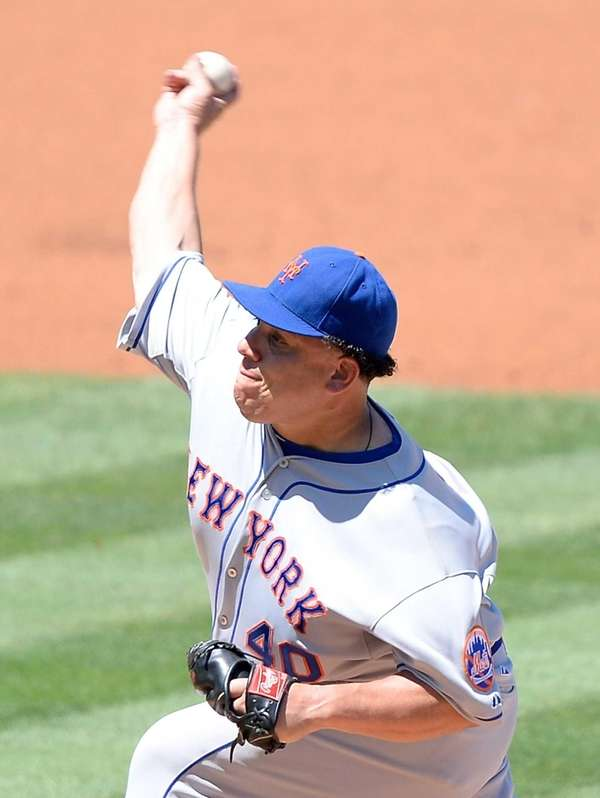 The Mets' Bartolo Colon delivers a pitch during
