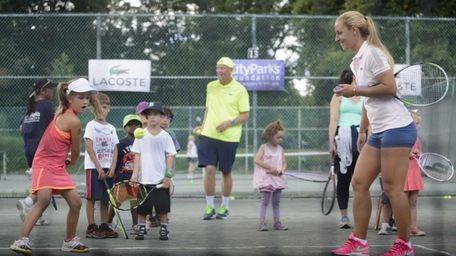 Professional tennis player Dominika Cibulková, right, takes part