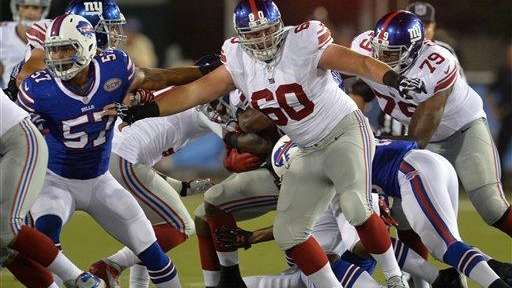 Giants center Weston Richburg (60) blocks against the