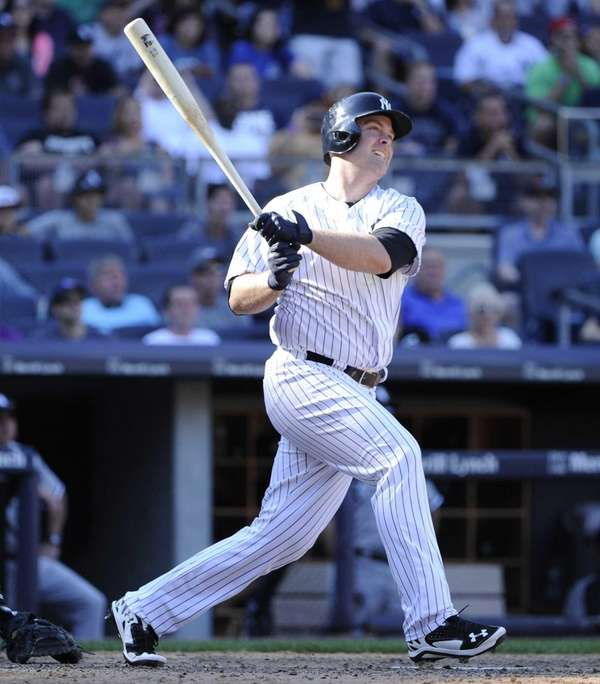 The Yankees' Brian McCann follows through on his