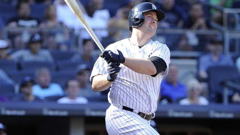 The Yankees' Brian McCann follows through on his