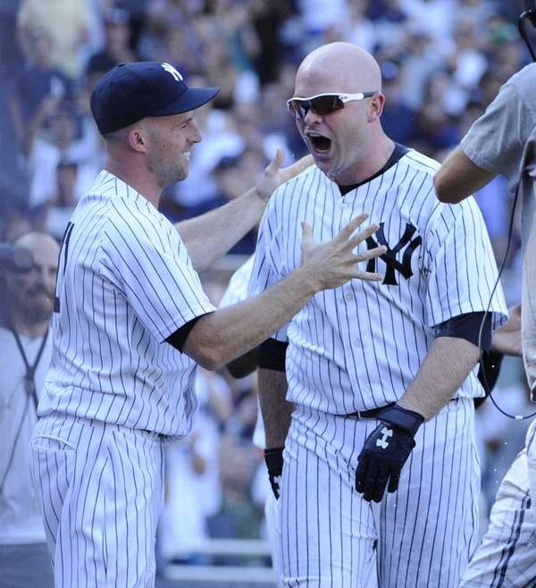 The Yankees' Brian McCann, right, reacts after Brett