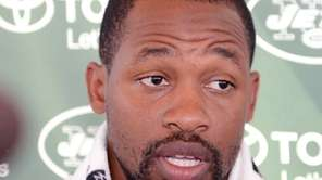 Jets cornerback Dimitri Patterson talks with reporters during