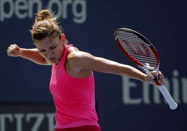 Simona Halep, of Romania, reacts after a shot