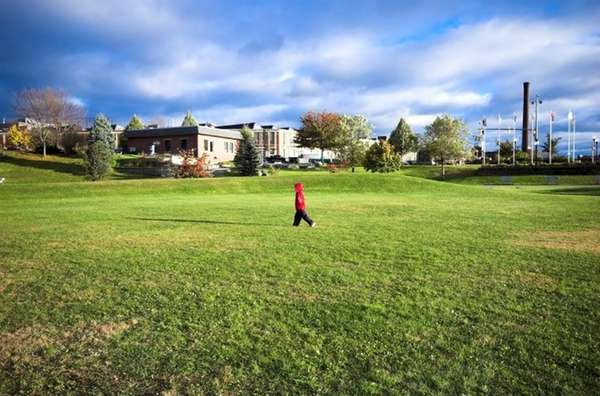 A child walks through a park in a