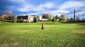 A child walks through a park in a