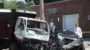 A landscaper's dump truck and a sedan collided